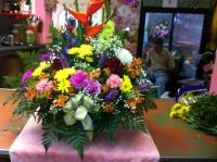 an arrangement with assorted flowers in a basket