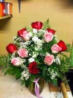 red and pink roses in a vase